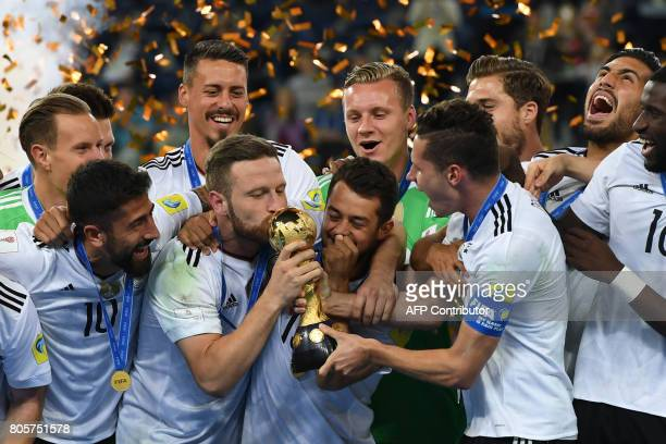 Germany's defender Shkodran Mustafi kisses the trophy after winning the 2017 Confederations Cup final football match between Chile and Germany at the...