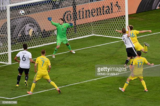 Germany's defender Shkodran Mustafi scores a goal during the Euro 2016 group C football match between Germany and Ukraine at the Stade Pierre Mauroy...