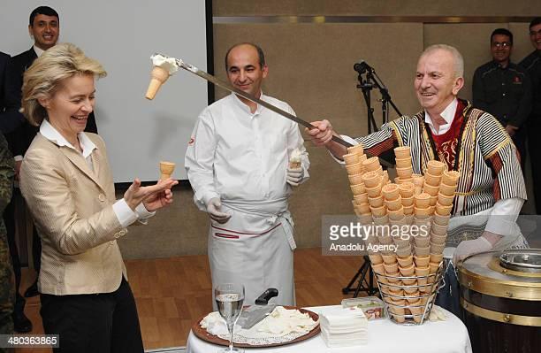 Germanys Defense Minister Ursula von der Leyen is handed a Turkish Maras ice cream made with goat milk salep sugar and mastic during a reception...