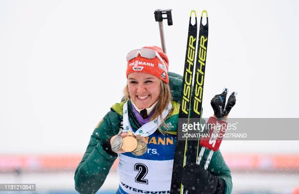 Germany's Denise Herrmann poses with her bronze medal after placing third in the women's 12,5 km mass start event at the IBU World Biathlon...