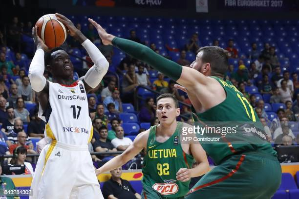 Germany's Dennis Schroder vies with Lithuania's Jonas Valanciunas during the FIBA EuroBasket 2017 championship match between Germany and Lithuania at...