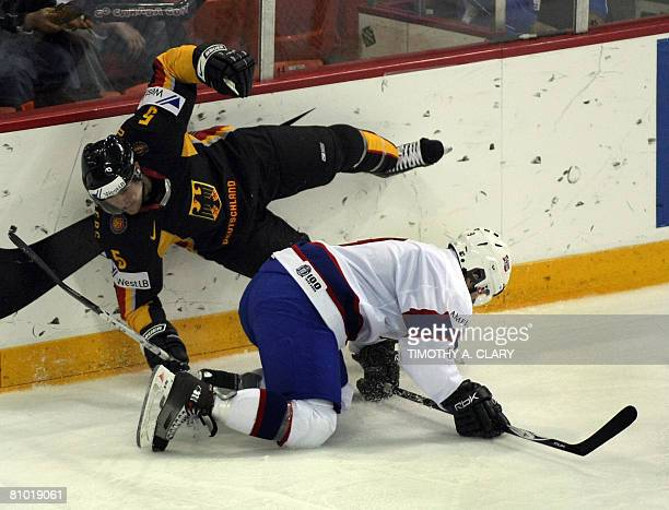 Germany's Dennis Seidenberg and Norway's Marius Holtet fall to the ice during the preliminary round of the 2008 IIHF World Hockey Championships at...