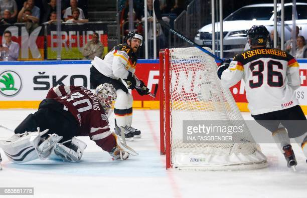 Germany's Dennis Seidenberg scores during the IIHF Men's World Championship Ice Hockey match between Germany and Latvia in Cologne western Germany on...