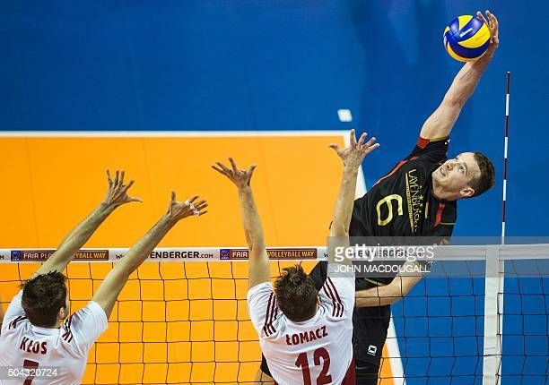 TOPSHOT Germany's Denys Kaliberda spikes the ball during the match for third place Germany vs Poland of the 2016 Men's Volleyball Olympic...