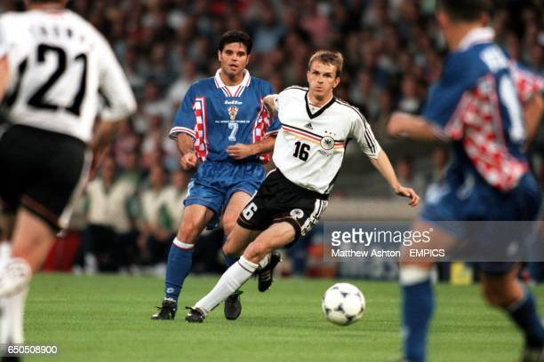 Germany's Dietmar Hamann tries to get away from Croatia's Aljosa Asanovic