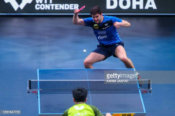 Germany's Dimitrij Ovtcharov competes against Taiwan's Lin Yun-Ju during the finals of the men's singles of the World Table Tennis Middle East Hub in...