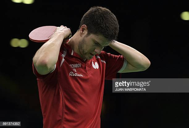 Germany's Dimitrij Ovtcharov reacts after losing a point in the men's team bronze medal table tennis match against South Korea at the Riocentro venue...