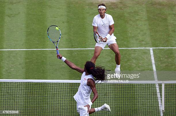 Germany's Dustin Brown jumps at the net to return against Spain's Rafael Nadal during their men's singles second round match on day four of the 2015...