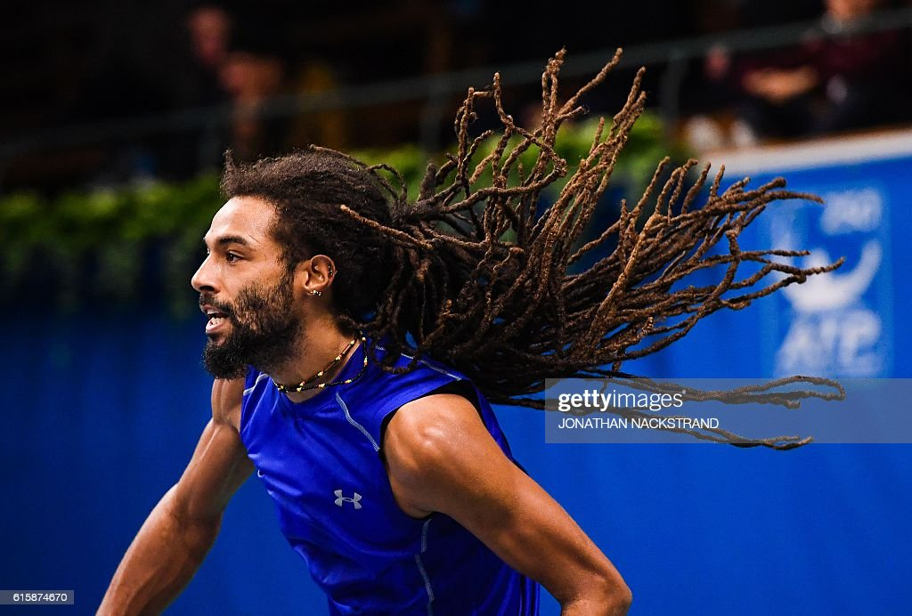 TOPSHOT - Germany's Dustin Brown serves to US's Jack Sock during the ATP Stockholm Open tennis tournament in Stockholm on October 20, 2016. / AFP / JONATHAN