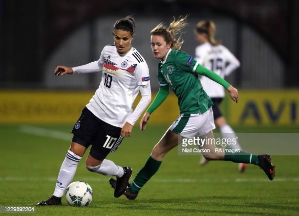 Germany's Dzsenifer Marozsan and Republic of Ireland's Heather Payne battle for the ball during the UEFA Women's Euro 2021 Qualifying Group I match...