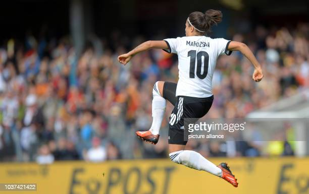 Germany's Dzsenifer Marozsan celebrates her 3-0 goal during the qualifying match for the FIFA World Cup between Germany and Russia at Stadion der...