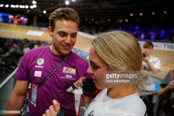 Germany's Emma Hinze celebrates winning gold with Germany's Maximilian Dornbach after the women's sprint final at the UCI track cycling World...