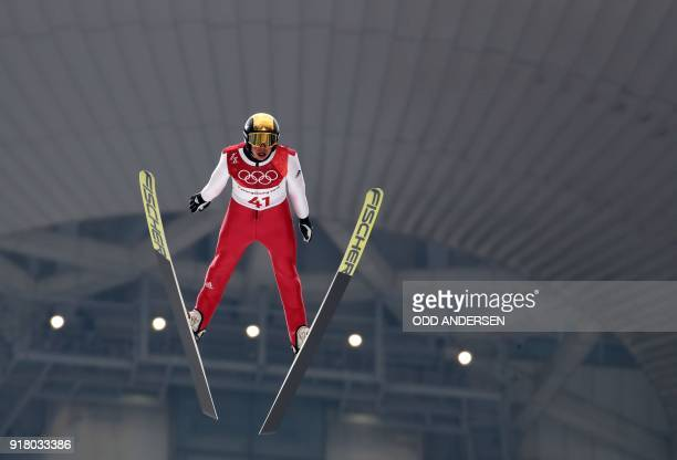 Germany's Eric Frenzel competes in the nordic combined men's individual NH/10km jumping trial round at the Alpensia ski jump centre during the...