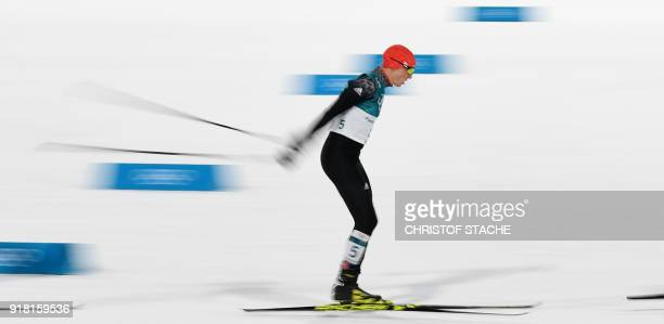 Germany's Eric Frenzel competes to win gold in the nordic combined men's individual normal hill NH/10km cross country final at the Alpensia cross...