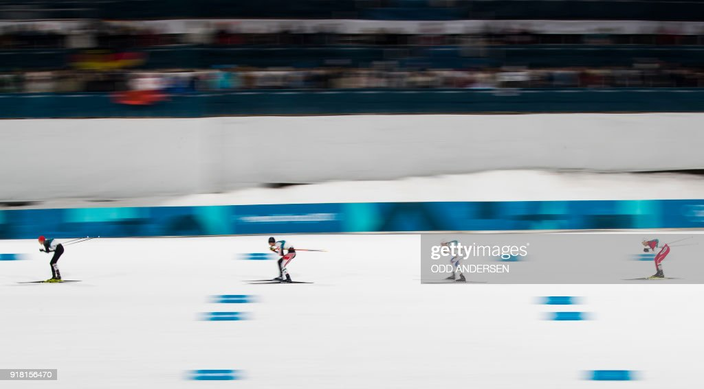 TOPSHOT - Germany's Eric Frenzel (L) is chased by Austria's Lukas Klapfer (2L), Norway's Jarl Magnus Riiber (2R) and Japan's Akito Watabe during the nordic combined men's individual normal hill NH/10km cross country final at the Alpensia cross country centre during the Pyeongchang 2018 Winter Olympic Games on February 14 , 2018 in Pyeongchang. / AFP PHOTO / Odd ANDERSEN