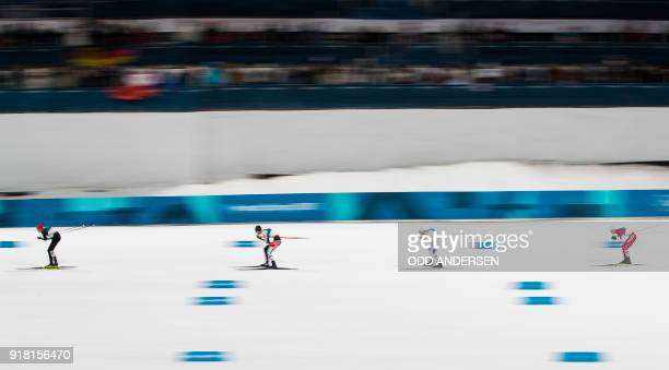 TOPSHOT Germany's Eric Frenzel is chased by Austria's Lukas Klapfer Norway's Jarl Magnus Riiber and Japan's Akito Watabe during the nordic combined...