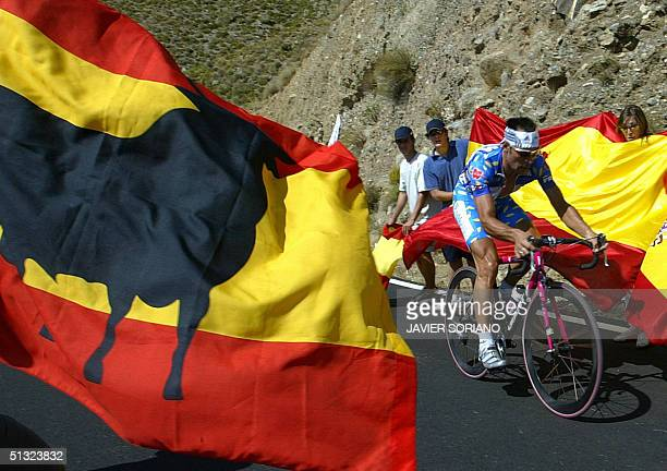Germany's Erik Zabel of T-Mobile Team rides in front of supporters with Spanish flags during the 15th stage of the 59th Tour of Spain cycling race, a...