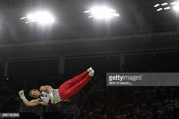 Germany's Fabian Hambuechen competes in the men's Horizontal bar event final of the Artistic Gymnastics at the Olympic Arena during the Rio 2016...