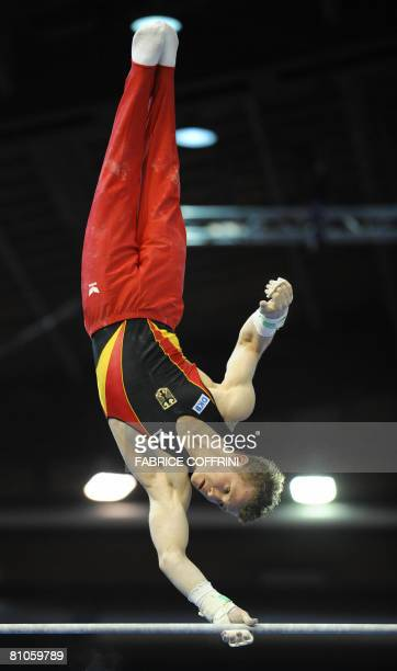 Germany's Fabian Hambuechen competes on the horizontal bar during the 28th European Men's Artistic Gymnastics Championships on May 10 2008 at Malley...