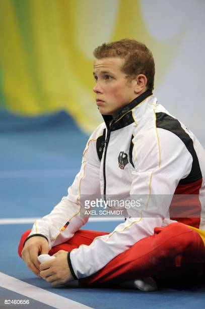 Germany's Fabian Hambuechen reacts after competing in the men's horizontal bars final of the artistic gymnastics event of the Beijing 2008 Olympic...
