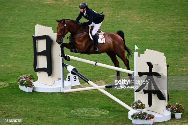 Germany's Fabian Liebig riding Merlot Castillon competes in the men's individual riding show jumping of the modern pentathlon during the Tokyo 2020...