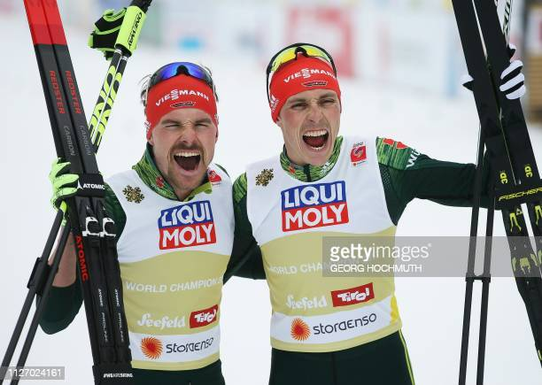 Germany's Fabian Riessle and Eric Frenzel celebrate after winning the Nordic Combined Men's Team Sprint HS130/2x75 km event at the FIS Nordic World...