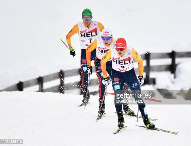 Germany's Fabian Riessle, Vinzenz Geiger and Eric Frenzel compete during the 15km competition of the FIS Nordic Combined World Cup in Seefeld,...