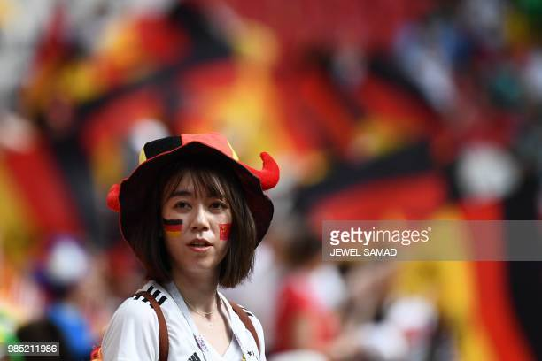 A Germany's fan poses prior to the Russia 2018 World Cup Group F football match between South Korea and Germany at the Kazan Arena in Kazan on June...