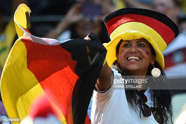 Germany's fan waves a flag before a Group G football match between Germany and Ghana at the Castelao Stadium in Fortaleza during the 2014 FIFA World...