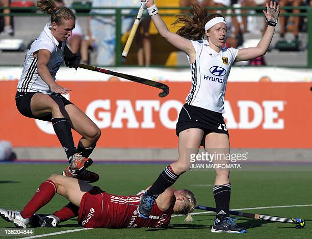 Germany's Fanny Rinne and Nina Hasselmann leap over England's Alex Danson during their Champions Trophy 2012 semifinal field hockey match in Rosario...