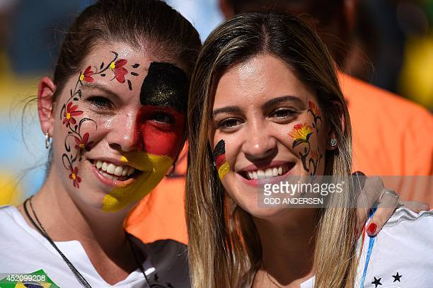 Germany's fans cheer prior to the kickoff of the 2014 FIFA World Cup final football match between Germany and Argentina at the Maracana Stadium in...