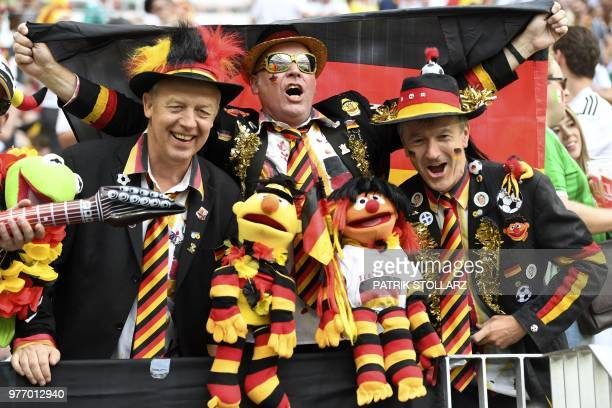 Germany's fans cheer prior to the Russia 2018 World Cup Group F football match between Germany and Mexico at the Luzhniki Stadium in Moscow on June...