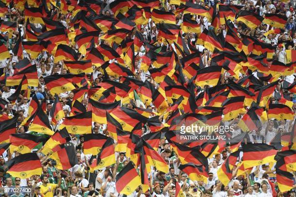 TOPSHOT Germany's fans wave German national flags as they cheer prior to the Russia 2018 World Cup Group F football match between Germany and Mexico...