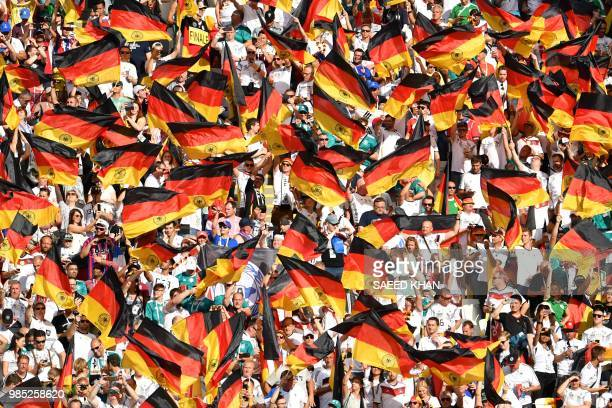Germany's fans wave German national flags during the Russia 2018 World Cup Group F football match between South Korea and Germany at the Kazan Arena...
