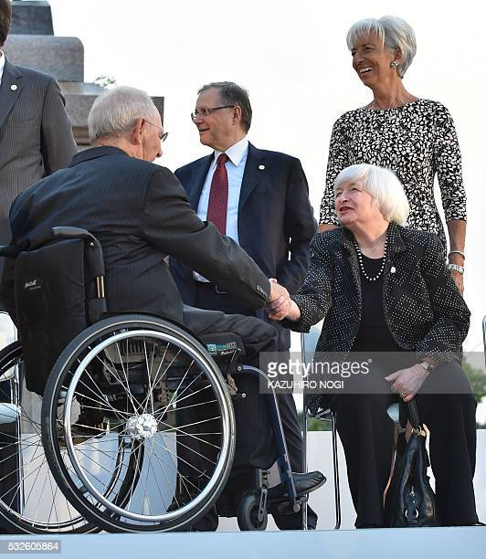 Germany's Federal Minister of Finance Wolfgang Schaeuble shakes hands with US FRB chair Janet Yellen prior to a photo session at the Sendai Castle...