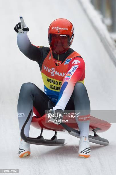 Germany's Felix Loch celebrates as he passes the finish line during the men's single at the Luge World Cup in Altenberg, Germany, 02 December 2017....