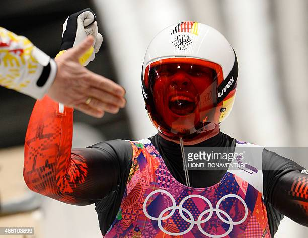 Germany's Felix Loch celebrates his Gold Medal in the Men's Luge final at the Sanki Sliding Center during the Sochi Winter Olympics on February 9...