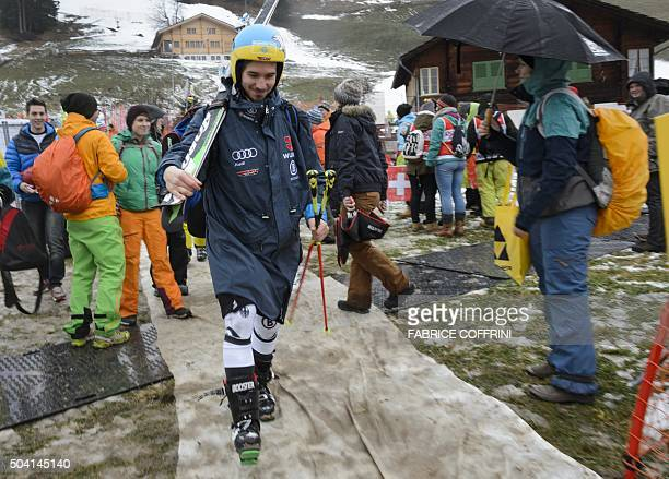 Germany's Felix Neureuther leaves after the men's giant slalom race at the FIS Alpine Skiing World Cup in Adelboden was cancelled due to bad weather...