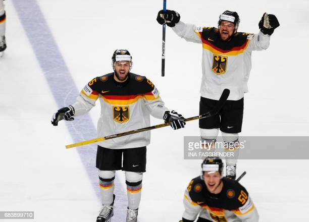 Germany's Felix Schultz Yannic Seidenberg and Patrick Hager celebrate after the penalty shootout of the IIHF Men's World Championship Ice Hockey...