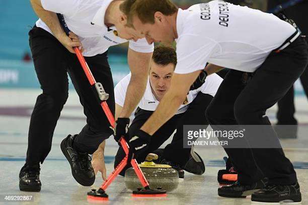 Germany's Felix Schulze throws the stone during the Men's Curling Round Robin Session 7 at the Ice Cube Curling Center during the Sochi Winter...