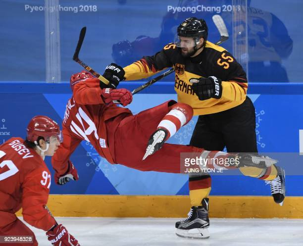 TOPSHOT Germany's Felix Schutz adn Russia's Yegor Yakovlev clash in the men's gold medal ice hockey match between the Olympic Athletes from Russia...