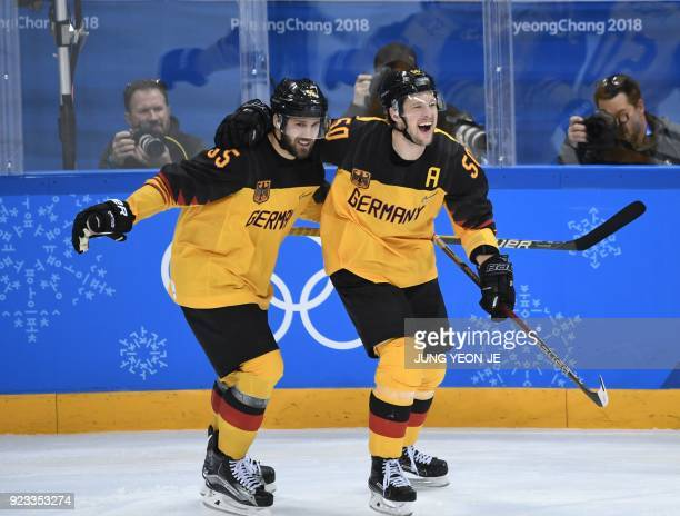 TOPSHOT Germany's Felix Schutz and Germany's Patrick Hager celebrate a goal in the men's semifinal ice hockey match between Canada and Germany during...