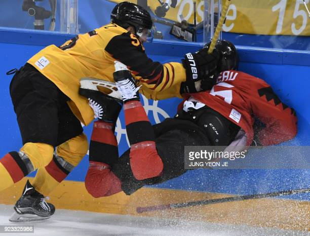 Germany's Felix Schutz checks Canada's Maxim Noreau in the men's semifinal ice hockey match between Canada and Germany during the Pyeongchang 2018...