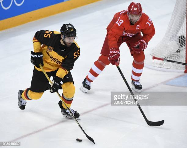 Germany's Felix Schutz tries to get past Russia's Pavel Datsyuk in the men's gold medal ice hockey match between the Olympic Athletes from Russia and...