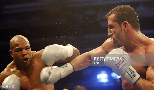 Germany's Firat Aslan exchanges punches with Darnell Wilson of the US in their WBA world championship cruiserweight title bout on May 4, 2008 in...