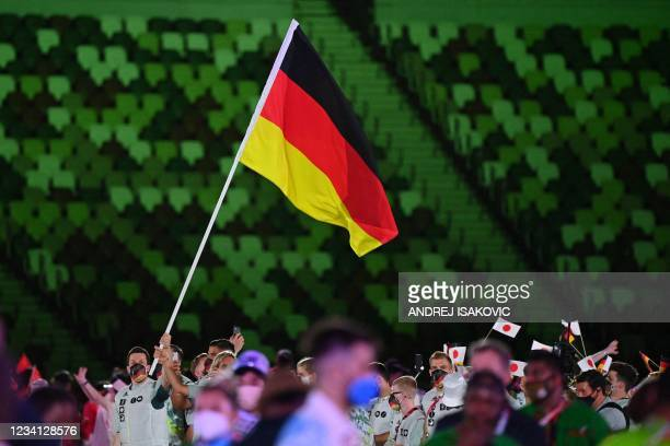 Germany's flag bearer Patrick Hausding leads the delegation as they parade during the opening ceremony of the Tokyo 2020 Olympic Games, at the...