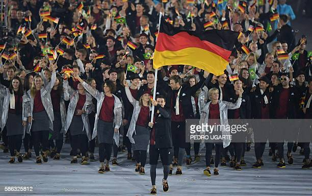 Germany's flagbearer Timo Boll leads his delegation during the opening ceremony of the Rio 2016 Olympic Games at the Maracana stadium in Rio de...