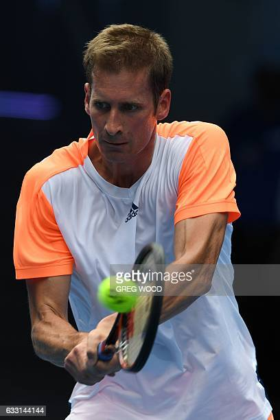 Germany's Florian Mayer hits a return against Spain's Rafael Nadal during their men's singles match on day two of the Australian Open tennis...
