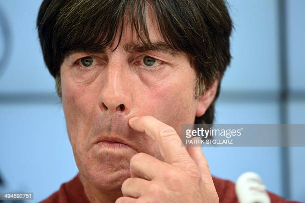 Germany's football head coach Joachim Loew gestures as he answers journalists' questions during a press conference of the German national football...