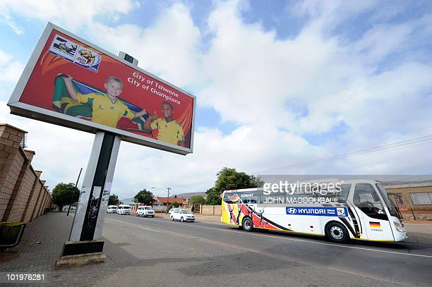 Germany's football team bus passes a billboard on its way to the Super stadium in Atteridgeville near Pretoria for a training session on June 11 2010...